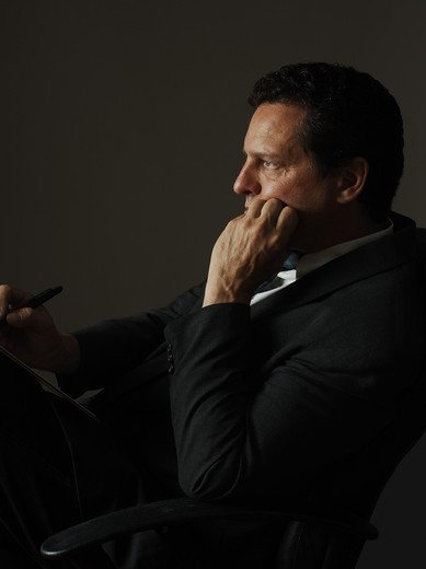 Stock Photo: 4193R-2009 business executive listening intently and taking notes