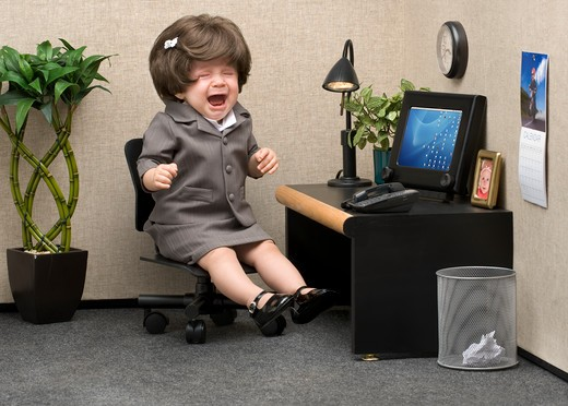Baby dressed in professional office attire crying at her desk : Stock Photo