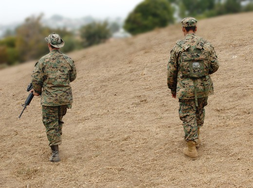 Two US Marines on patrol : Stock Photo