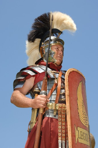 Stock Photo: 4193R-2153 1st century Roman soldier in armour, rank of Optio shot against a blue sky