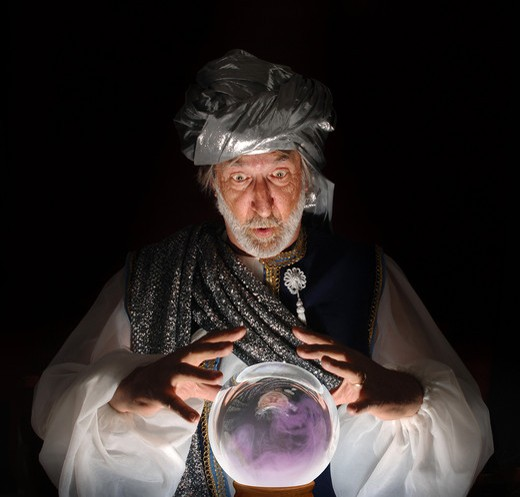 Swami gazing into a crystal ball : Stock Photo