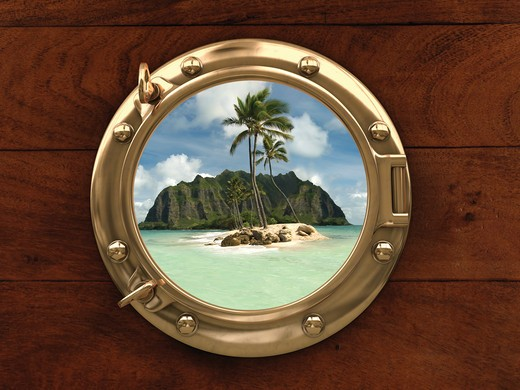 Porthole inside a ship with a view of a deserted island : Stock Photo