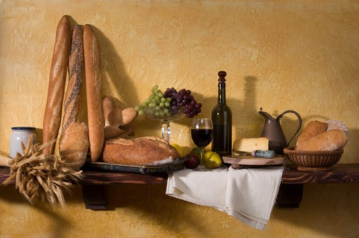 Stock Photo: 4193R-286 Bread, cheese, wine and grapes against a tuscan plaster wall