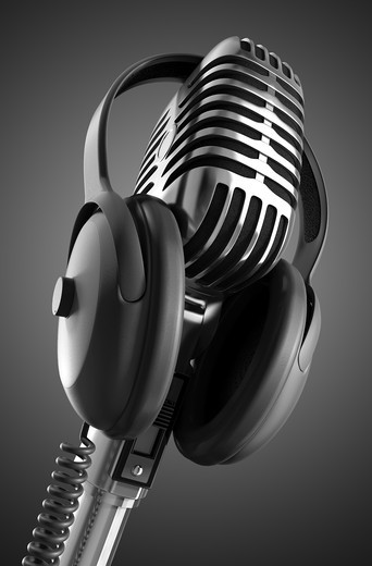 Black & White 50's microphone with headphones & clipping path included for those who need a different background. : Stock Photo