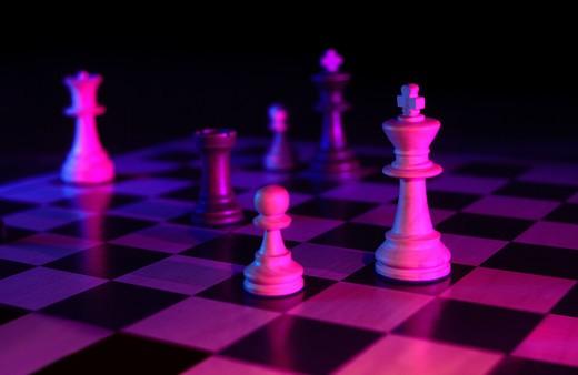 Stock Photo: 4193R-391 chess pieces gelled on dark background
