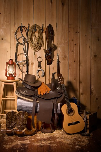 Stock Photo: 4193R-429 Still life of cowboy paraphernalia in the tack room of a barn