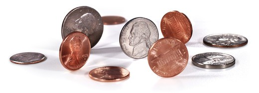 pennies, nickels, dimes, quarters on white : Stock Photo