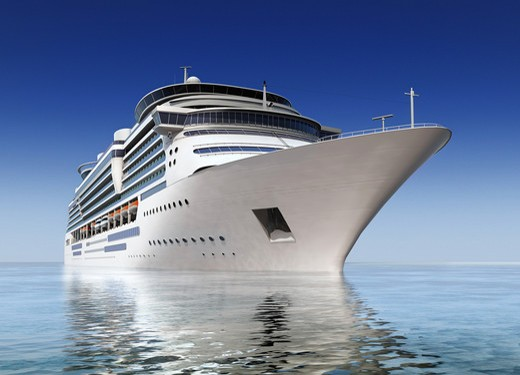 luxury white cruise ship shot at angle at water level on a clear day with calm seas and blue sky : Stock Photo