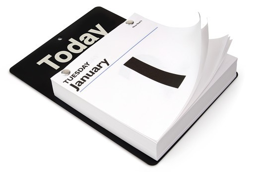 Stock Photo: 4193R-520 Tear-off day calendar shot at an angle on white with clipping path