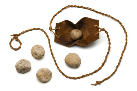 Sling and five smooth stones used by David to kill Goliath on a white background : Stock Photo