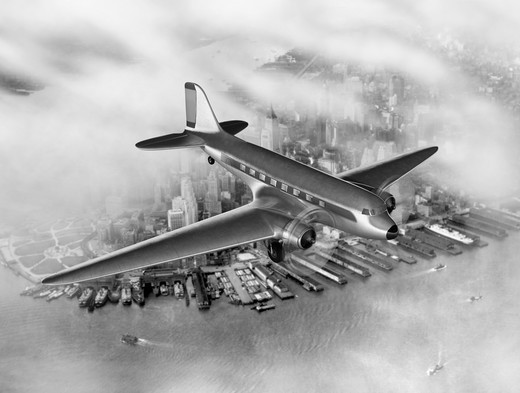 Stock Photo: 4193R-535 Vintage image of a Douglas DC-3 over New York City