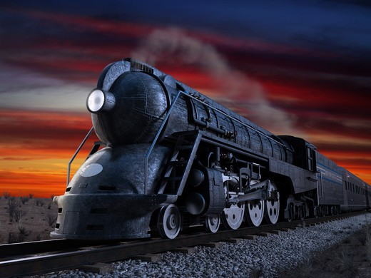 Stock Photo: 4193R-565 Dreyfuss J3A Streamliner locomotive known as the 20th Century Limited shot at twilight during a sunset