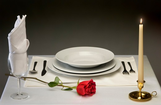 Stock Photo: 4193R-575 Elegant table setting with rose and candlelight