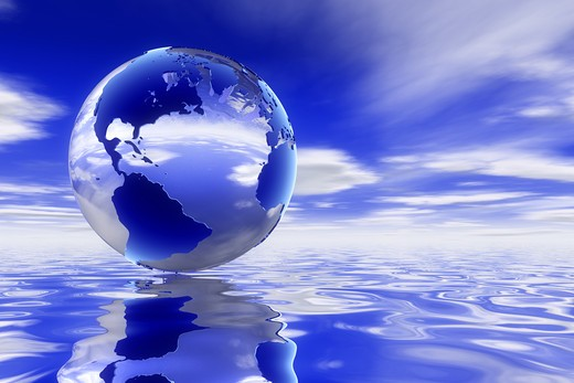 Stock Photo: 4193R-622 A high quality Glass 3d earth over a clean ocean reflecting the deep blue skyscape.
