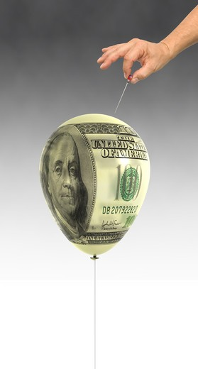 Balloon mapped with a 100 Dollar bill about to be popped with a straight pin : Stock Photo