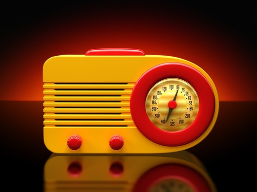 Vintage plastic radio on a dramatic background : Stock Photo