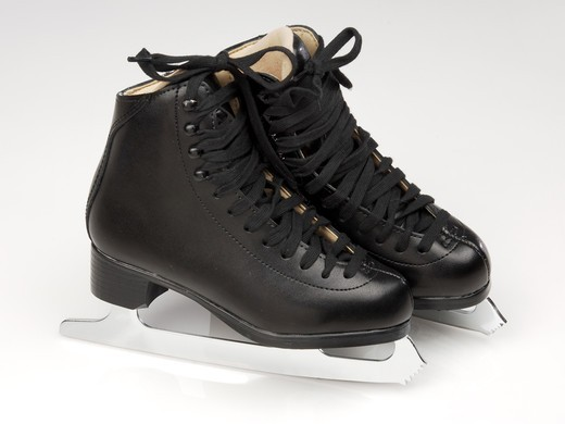 Stock Photo: 4193R-687 black pair of ice skates on ice