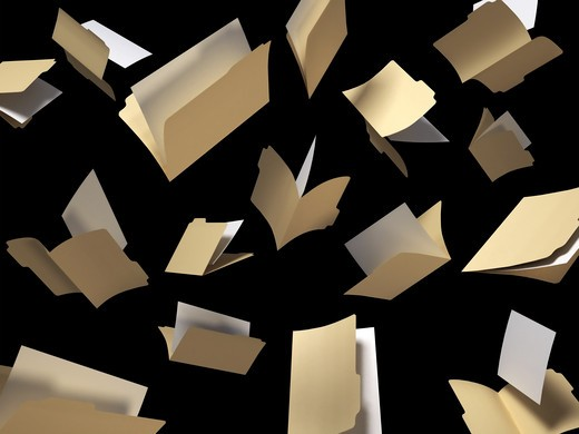 Stock Photo: 4193R-689 A shot of file folders scattered in the air on a black background