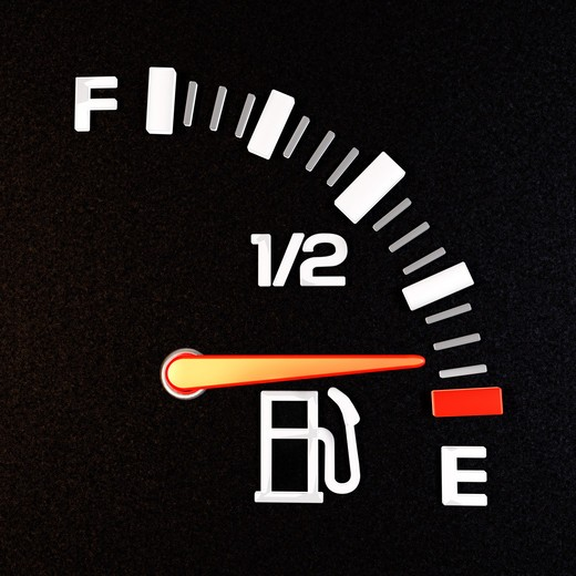 A gas gauge showing empty : Stock Photo