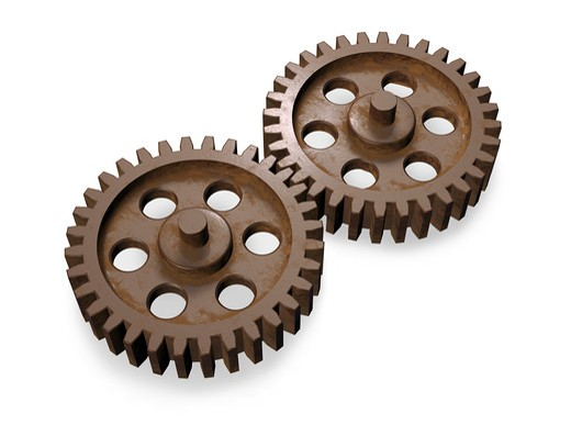 3d concept art showing two equal weathered gears working together. : Stock Photo