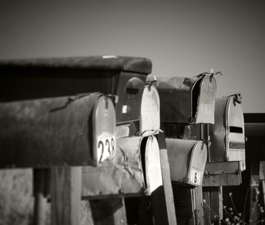 Stock Photo: 4193R-827 A row of grungy mailboxes in the country