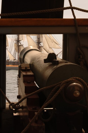 Stock Photo: 4193R-836 Gun cannon on vintage sailing ship aiming at another sailing vessel