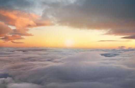 high altitude sunrise in layered cloudscape : Stock Photo
