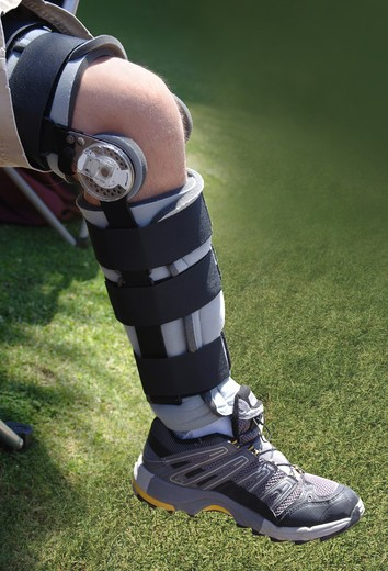 Stock Photo: 4193R-966 knee brace on leg