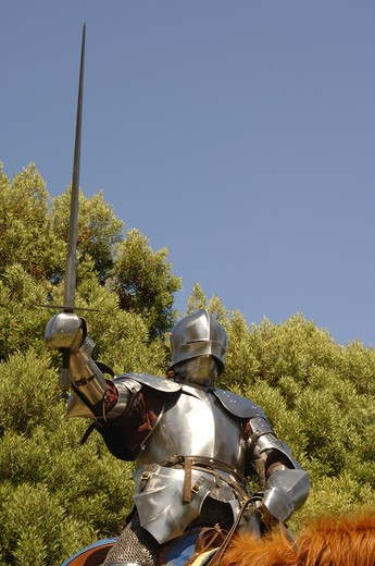 Stock Photo: 4193R-967 15th Century English knight in shining armour in a charge position on horseback