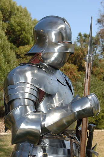 Medium side shot of a 15th century English knight in armour : Stock Photo