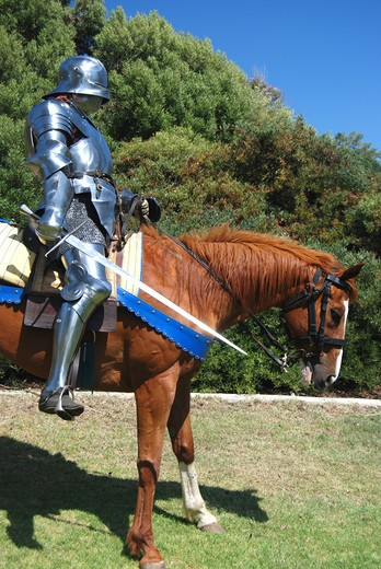Stock Photo: 4193R-970 15th century English knight in full armour holding a sword on horseback