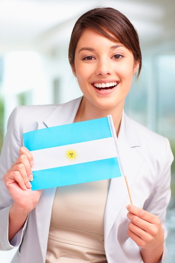Portrait of a happy young female holding an Argentina flag : Stock Photo