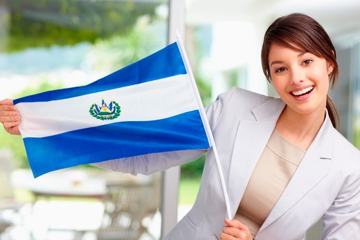 Stock Photo: 4197R-11787 Portrait of a cute young female displaying an El Salvadorian flag