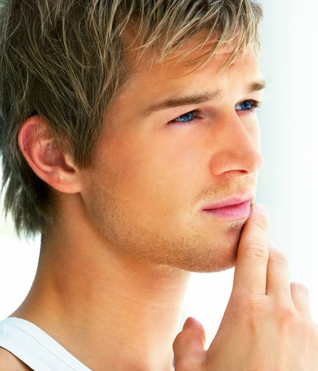 Closeup portrait of a handsome young man looking away : Stock Photo