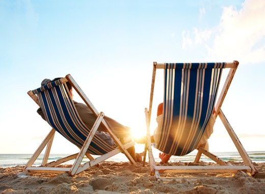 Stock Photo: 4197R-14057 Image of a tired young couple resting on the beach