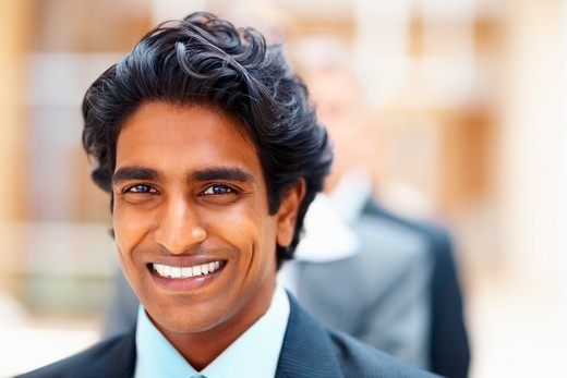 Closeup portrait of a successful young Asian ethnic business man : Stock Photo