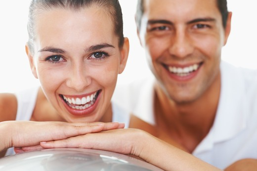 Closeup portrait of cheerful young woman with personal trainer : Stock Photo