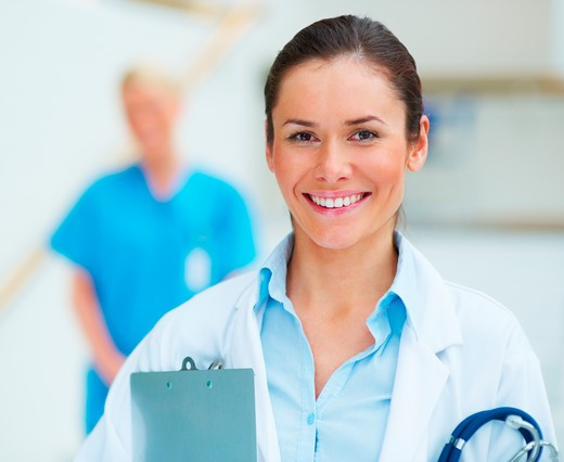 Stock Photo: 4197R-27967 Closeup of smiling young female medical doctor