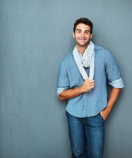 Handsome man tugging on scarf : Stock Photo