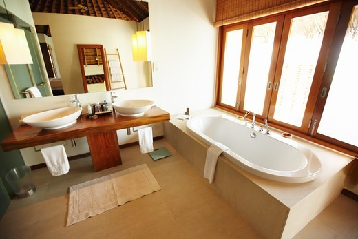 Wide-angle view of a tiled bathroom : Stock Photo