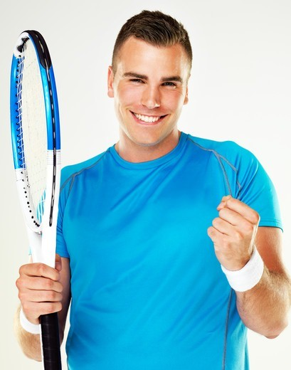Stock Photo: 4197R-49738 Portrait of a young male tennis player celebrating a victory