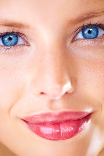 Stock Photo: 4197R-50035 Closeup portrait of a striking young woman with luscious lips and deep blue eyes