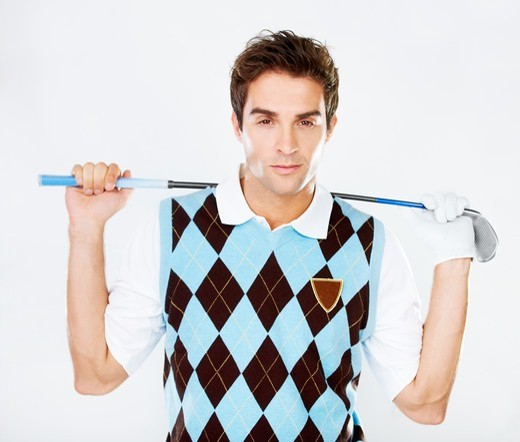 Stock Photo: 4197R-50076 Suave golfer holding his club while isolated on white