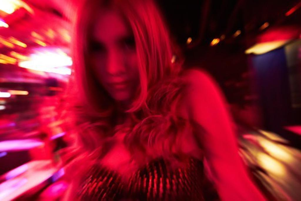 Blonde transgender woman in nightclub - motion blur : Stock Photo