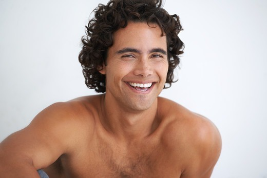 Stock Photo: 4197R-50895 Gorgeous young man smiling at you without a shirt