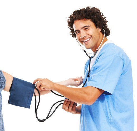 Stock Photo: 4197R-51150 Portrait of a young doctor taking someone's blood pressure