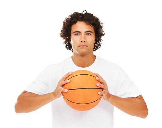 Stock Photo: 4197R-51157 Portrait of a young man holding a basketball