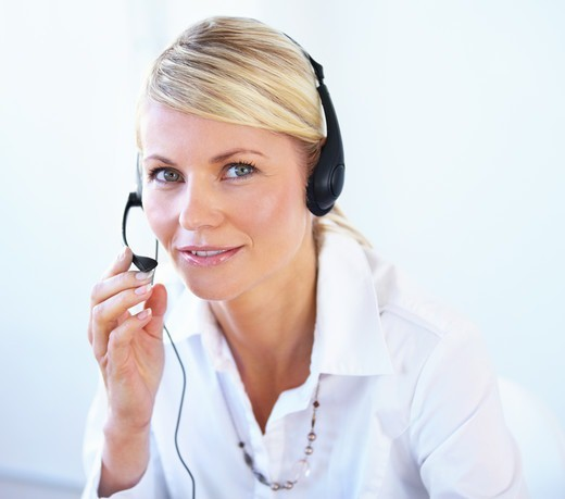 Stock Photo: 4197R-51851 Attractive young call center agent wearing a headset - portrait