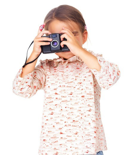 Stock Photo: 4197R-52118 Pretty small girl playing as photographer isolated on white background