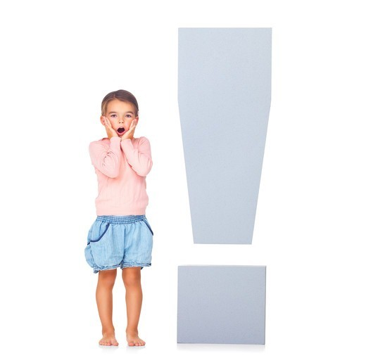 Surprised little girl with exclamation marks over white background : Stock Photo